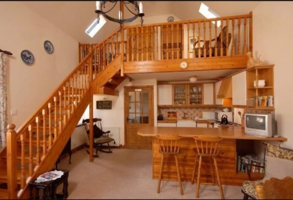 Auchingoul Cottage Kitchen/diner & Mezzanine Balcony to bedroom.
