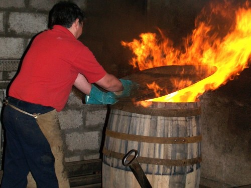 Firing the new oak barrel at the Cooperage